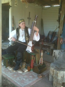 Playing the dilruba at the Four Winds Ren Faire in Tyler, Texas